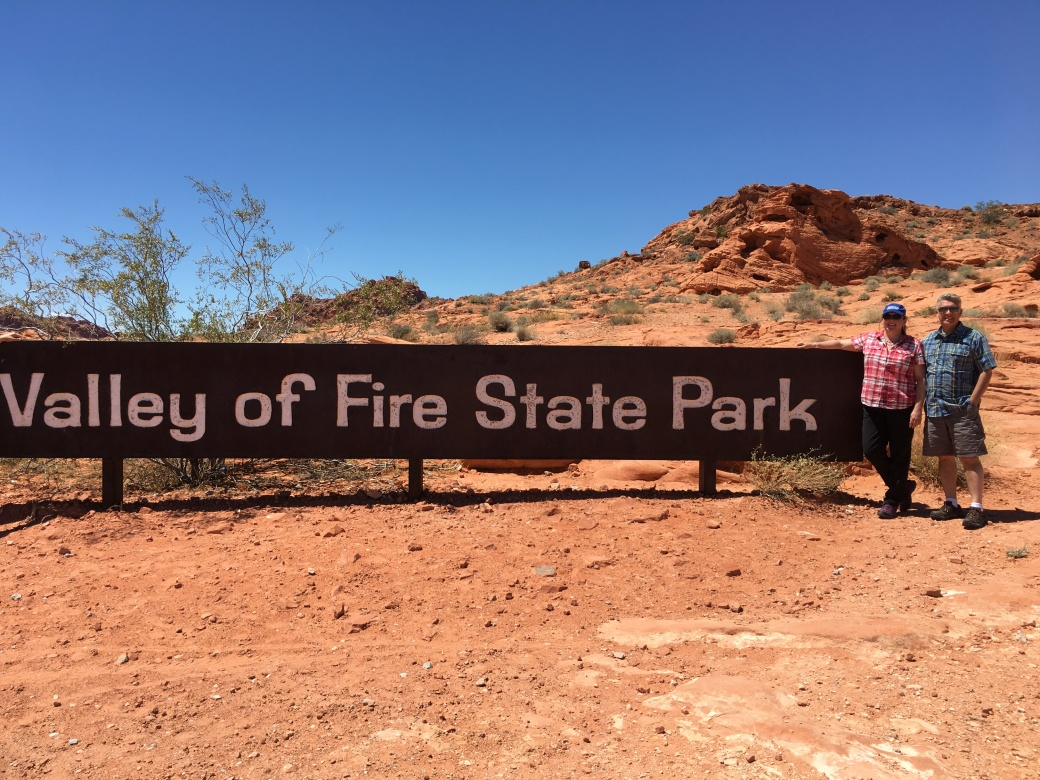 Couple at Valley of Fire State Park sign