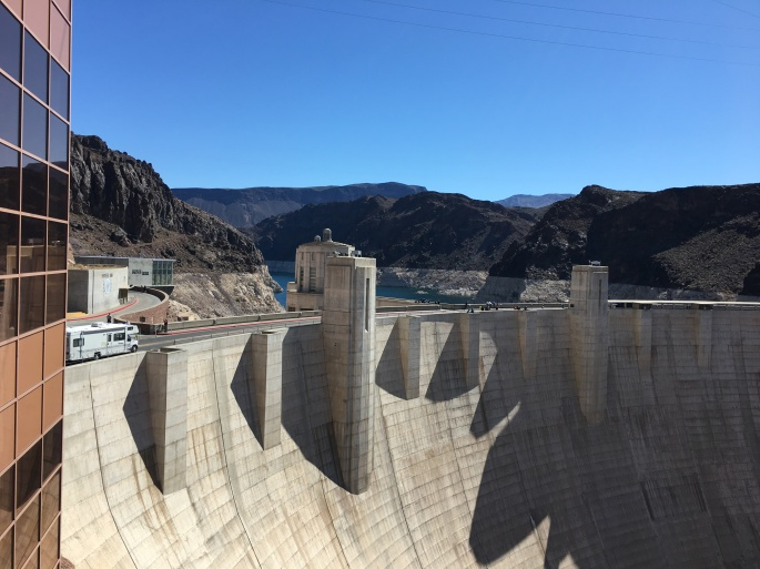 Concrete walls of Hoover Dam with hills behind