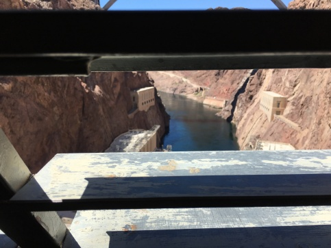 Looking out of the side of the concrete wall in Hoover Dam