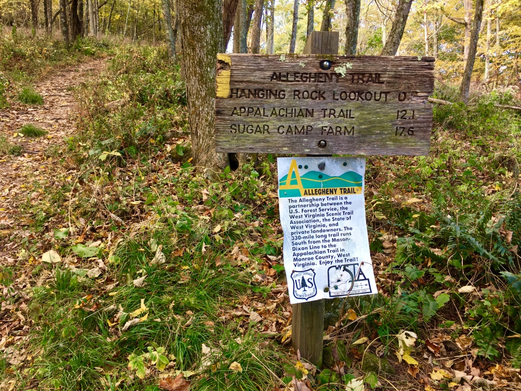 Wooden sign for Allegheny Trail marking distances to Hanging Rock Lookout, Appalachian Trail, and Sugar Camp Farm